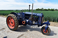 BNPS.co.uk (01202) 558833. <br /> Pic: Cheffins/BNPS<br /> <br /> Pictured: A Fordson E27n rowcrop tractor sold for £3600. <br /> <br /> A farming family is today celebrating after their incredible collection of almost 100 vintage tractors sold for a staggering £1million.<br /> <br /> Father and son duo Ian and Martin Liddell began hoarding the agricultural vehicles at their arable farm in the 1980s.<br /> <br /> Their fleet of tractors was so large that they had to be stored in three barns.<br /> <br /> The prized collection sparked a worldwide bidding war when it was sold with auctioneers Cheffins, of Cambridge, after the family decided to part with the tractors to free up space on their Essex farm to pursue other projects.