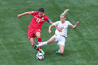 June 21, 2015: Christine SINCLAIR of Canada and Lara DICKENMANN of Switzerland fight for the ball during a round of 16 match between Canada and Switzerland at the FIFA Women's World Cup Canada 2015 at BC Place Stadium on 21 June 2015 in Vancouver, Canada. Canada won 1-0. Sydney Low/Asteriskimages.com