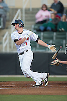 Cody Daily (31) of the Kannapolis Intimidators follows through on his swing against the Hickory Crawdads at Kannapolis Intimidators Stadium on April 9, 2016 in Kannapolis, North Carolina.  The Crawdads defeated the Intimidators 6-1 in 10 innings.  (Brian Westerholt/Four Seam Images)