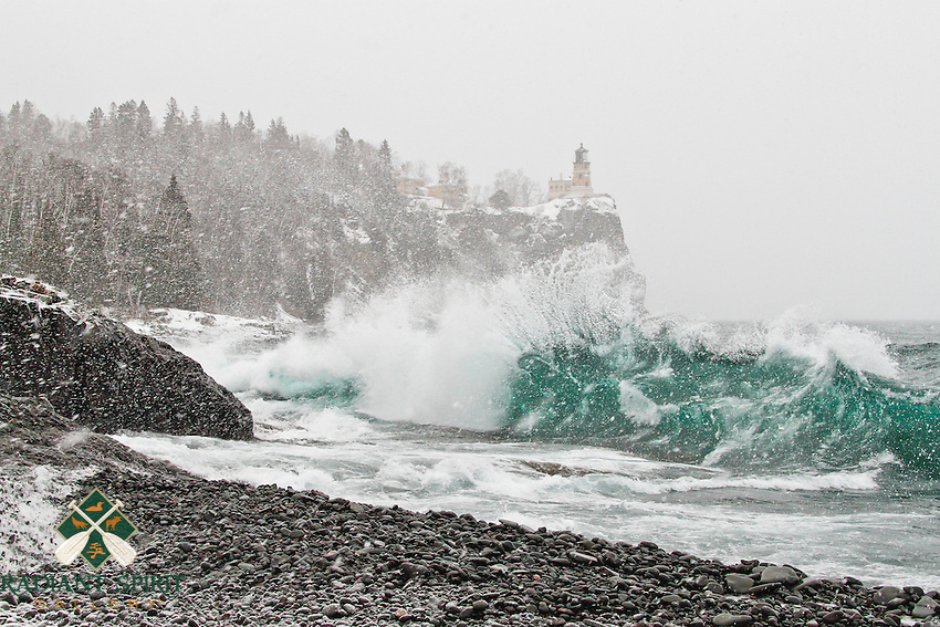 """""""Winter Storm at Split Rock Lighthouse""""<br /> <br /> The lighthouses on the Great Lakes were built to safely guide ships through storms such as this. Now standing silent yet picturesque, they are proud ambassadors of a bygone era.<br /> <br /> This photograph was composed along Lake Superior's North Shore during a storm with wind-driven snow. The natural color of the water was incredible! (Nature's palette, including the water color, was not altered in post-processing.)"""