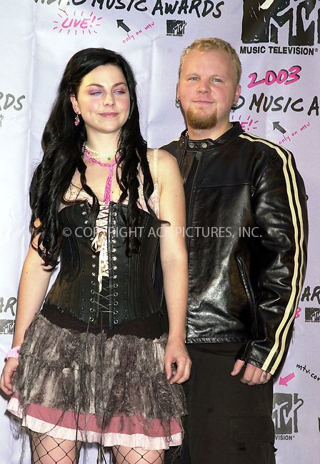 Amy Lee and Ben Moody of Evanescence at 2003 Video Music Awards. New York, August 28, 2003. Please byline: NY Photo Press.   ..*PAY-PER-USE*      ....NY Photo Press:  ..phone (646) 267-6913;   ..e-mail: info@nyphotopress.com
