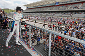 Colton Herta, Harding Steinbrenner Racing Honda celebrates on the podium with sparkling cider