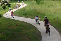 OFF AND RIDING<br />Young riders and their coaches head out on Wednesday June 9 2021 on their bikes during a youth cycling camp at Coler Mountain Bike Preserve in Bentonville. Oz Kids Summer Camps for youth cyclists age 5 to 9 will take place through mid August at the Coler preserve. Buddy Pegs youth cycling program, on Wishing Spring Road in Bentonville, runs the camps, said Greg Vogel with Buddy Pegs. For details visit buddypegs.com. Go to nwaonline.com/210610daily/ to see more photos.<br />(NWA Democrat-Gazette/Flip Putthoff)