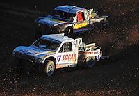 Dec. 10, 2011; Chandler, AZ, USA;  LOORRS pro 2 unlimited driver Carl Renezeder (17) and Greg Adler (10) during round 15 at Firebird International Raceway. Mandatory Credit: Mark J. Rebilas-