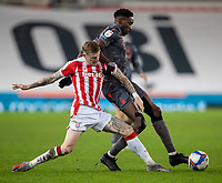 29th December 2020; Bet365 Stadium, Stoke, Staffordshire, England; English Football League Championship Football, Stoke City versus Nottingham Forest; Sammy Ameobi of Nottingham Forest is tackled by James McClean of Stoke City