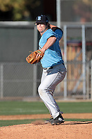 Cole Warren #21 of the Rhode Island Rams pitches against the Cal State Northridge Matadors at Matador Field on March 14, 2012 in Northridge,California. Rhode Island defeated Cal State Northridge 10-8.(Larry Goren/Four Seam Images)