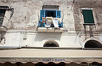 Washing hangs above a bar on Ischia island in the Tyrrhenian Sea, at the northern end of the Gulf of Naples.