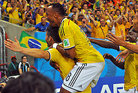 BRASILIA - BRASIL -28-06-2014. James Rodriguez (#10) jugador de Colombia (COL) celebra un gol anotado a Uruguay (URU) durante partido de los octavos de final por la Copa Mundial de la FIFA Brasil 2014 jugado en el estadio Arena Pantanal de Cuiaba./ James Rodriguez (#10) player of Colombia (COL) celebrates a goal scored to Uruguay (URU) during the match of the Round of 16 for the 2014 FIFA World Cup Brazil played at Arena Pantanal stadium in Cuiaba. Photo: VizzorImage / Alfredo Gutiérrez / Contribuidor