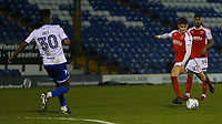 Fleetwood Town's Harrison Biggins has a shot at goal (right)  during the The Checkatrade Trophy match between Bury and Fleetwood Town at Gigg Lane, Bury, England on 9 January 2018. Photo by Juel Miah/PRiME Media Images.