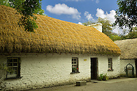 Historic house with thatched roof. Bunratty Castle, ireland