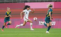 KASHIMA, JAPAN - JULY 27: Christen Press #11 of the United States races along the sideline before a game between Australia and USWNT at Ibaraki Kashima Stadium on July 27, 2021 in Kashima, Japan.
