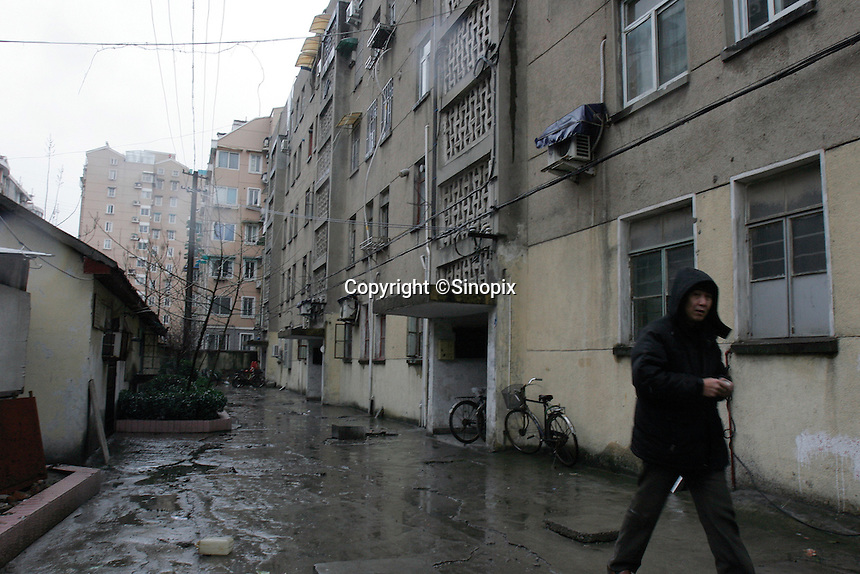 A view of apartment block where 11 year old Liu Fangyuan (Yuan Yuan) lives with her parents and grandmother in Nanjing, China. In 2002, Yuan Yuan's aunt poured sulfuric acid on her face after losing a housing dispute with Yuan Yuan's father in regards to a 40 squared meter in this block. The attack blinded and seriously disfigured Yuan Yuan, while her aunt is serving a life sentence in prison, Yuan Yuan and her family awaits a controversial face transplant...PHOTO BY SHEN / SINOPIX