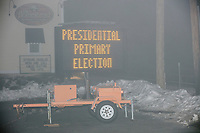 """A temporary sign displays the message """"Presidential Primary Election / Tues Feb 11 / 7:00AM to 7:00PM"""" in the parking lot outside the Merrimack Fire Department Reeds Ferry Station in  Merrimack, New Hampshire, on Mon., Feb. 10, 2020."""