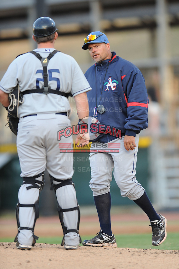 Asheville Tourists Pitching Coach Joey Eischen #28 goes to the mound for a discussion during a game vs. the Hickory Crawdads at L.P. Franz Stadium in Hickory,  North Carolina;  April 7, 2011.  Hickory defeated Asheville 4-2.  Photo By Tony Farlow/Four Seam Images