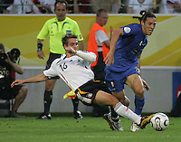 Italian midfielder (16) Mauro Camoranesi has the ball tackled away by German defender (16) Philipp Lahm.  Italy defeated Germany, 2-0, in overtime in their FIFA World Cup semifinal match at FIFA World Cup Stadium in Dortmund, Germany, July 4, 2006.