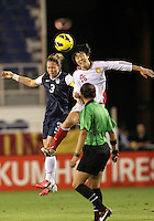 BOCA RATON, FL - DECEMBER 15, 2012: Christie Rampone (3) of the USA WNT goes up for a header with Zhang Rui (25) of China WNT during an international friendly match at FAU Stadium, in Boca Raton, Florida, on Saturday, December 15, 2012. USA won 4-1.