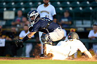 Tampa Tarpons catcher Antonio Gomez (5) attempts to tag Jackson Glenn (10) sliding home safely during Game Two of the Low-A Southeast Championship Series against the Bradenton Marauders on September 22, 2021 at LECOM Park in Bradenton, Florida.  (Mike Janes/Four Seam Images)