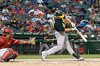 Oakland Athletics outfielder Conor Jackson (28) swings against the Texas Rangers in American League baseball on May 11, 2011 at the Rangers Ballpark in Arlington, Texas. (Photo by Andrew Woolley / Four Seam Images)