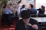 Senior man, Oap eating lunch. Chips. Regency Café  Westminster London SW1 UK.