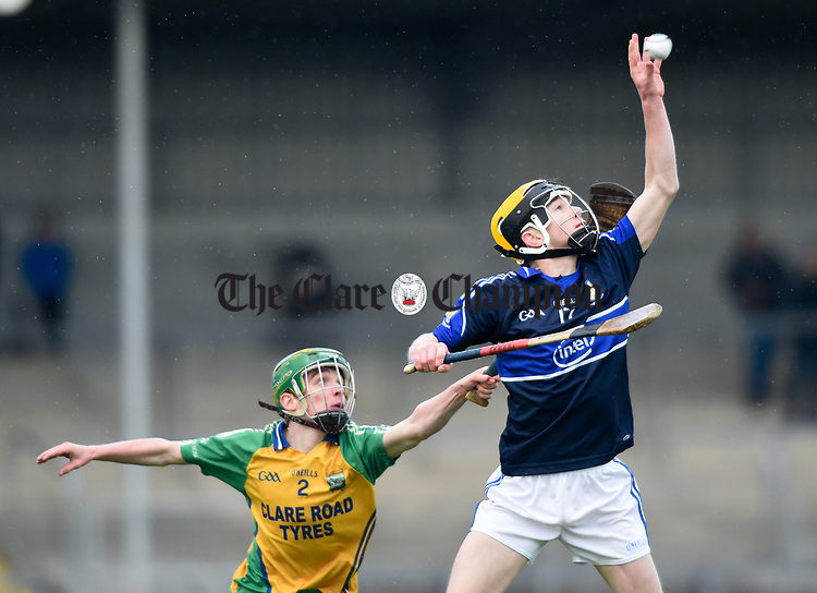 James Mc Guire of Kilmaley in action against Mark Barry of Inagh-Kilnamona during their Minor A county final at Cusack Park. Photograph by John Kelly.