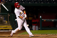 Niko Vasquez (7) of the Springfield Cardinals makes solid contact during a game against the Frisco RoughRiders on April 14, 2011 at Hammons Field in Springfield, Missouri.  Photo By David Welker/Four Seam Images.