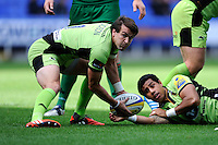 Lee Dickson of Northampton Saints passes as Ken Pisi of Northampton Saints looks on during the Premiership Rugby match between London Irish and Northampton Saints at the Madejski Stadium on Saturday 4th October 2014 (Photo by Rob Munro)