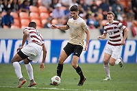 Houston, TX -  Sunday, December 11, 2016: Jon Bakero (7) of the Wake Forest Demon Deacons brings the ball up the field in the first half against the Stanford Cardinal at the  NCAA Men's Soccer Finals at BBVA Compass Stadium.