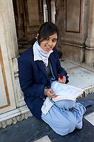 India, Dehradun.  Young Female Student Studying at the Durbar Shri Guru Ram Rai Ji Maharaj, a Sikh Temple Built in 1707.