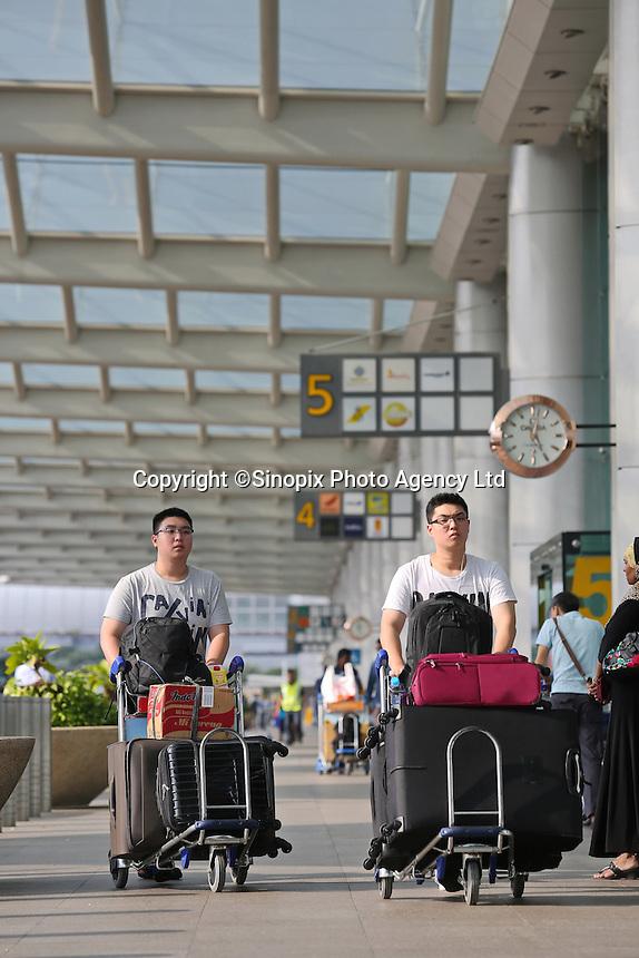 Passengers prepare to depart  Changi airport, Terminal 1, Singapore, 13 August 2015.