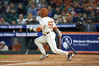 Cam Williams (55) of the Texas Longhorns follows through on his swing against the Arkansas Razorbacks in game six of the 2020 Shriners Hospitals for Children College Classic at Minute Maid Park on February 28, 2020 in Houston, Texas. The Longhorns defeated the Razorbacks 8-7. (Brian Westerholt/Four Seam Images)