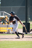 Chicago White Sox third baseman Bryce Bush (24) follows through on his swing during an Instructional League game against the Oakland Athletics at Lew Wolff Training Complex on October 5, 2018 in Mesa, Arizona. (Zachary Lucy/Four Seam Images)