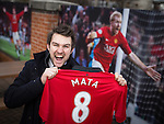 © Joel Goodman - 07973 332324 . 27/01/2014 . Manchester , UK . ANDY LEATHLEY (28) (correct) from Chorlton poses with his new shirt in front of iconic prints in front of Old Trafford . Fans with new MATA 8 shirts in front of Old Trafford Football Ground as it's announced that Spaniard Juan Mata ( Juan Manuel Mata García ) has signed for Manchester United  . Photo credit : Joel Goodman