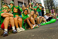 Photography of the Charlotte NC St. Patrick's Day Parade in March 2012. Image shows children watching the parade. Photography is part of a series of St. Patrick's Day Parade photos in Charlotte, NC.