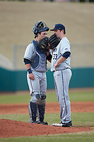 Xavier Musketeers catcher Nate Soria (5) talks with pitcher Trent Astle (33) at the mound against the Penn State Nittany Lions at Coleman Field at the USA Baseball National Training Center on February 25, 2017 in Cary, North Carolina. The Musketeers defeated the Nittany Lions 7-5 in game two of a double header. (Brian Westerholt/Four Seam Images)