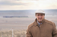 Julio Viola, president and owner with the vineyard and winery in the background Bodega Del Fin Del Mundo - The End of the World - Neuquen, Patagonia, Argentina, South America