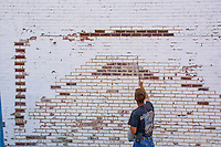 Workers pressure cleans a parking lot wall in Uptown Westerville.