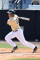 UCF Knights catcher / third baseman Chris Taladay #20 at bat during a game against the Siena Saints at the UCF Baseball Complex on March 4, 2012 in Orlando, Florida.  Central Florida defeated Siena 15-2.  (Mike Janes/Four Seam Images)
