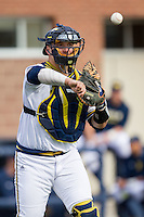 Michigan Wolverines catcher Harrison Wenson (7) makes a throw to first base against the Oakland Golden Grizzlies on May 17, 2016 at Ray Fisher Stadium in Ann Arbor, Michigan. Oakland defeated Michigan 6-5 in 10 innings. (Andrew Woolley/Four Seam Images)