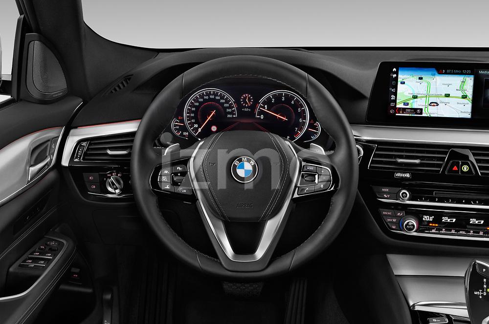 Car pictures of steering wheel view of a 2018 BMW 6 series gran turismo Sport 5 Door Hatchback