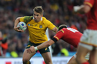 Drew Mitchell of Australia is tackled by Dan Biggar of Wales during Match 35 of the Rugby World Cup 2015 between Australia and Wales - 10/10/2015 - Twickenham Stadium, London<br /> Mandatory Credit: Rob Munro/Stewart Communications