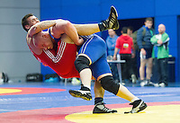11 MAY 2014 - SHEFFIELD, GBR - Mark Cocker attempts to overpower Dan Boyal during one of his 97kg category freestyle matches at the British 2014 Senior Wrestling Championships at EIS in Sheffield, Great Britain (PHOTO COPYRIGHT © 2014 NIGEL FARROW, ALL RIGHTS RESERVED)