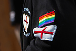 © Joel Goodman - 07973 332324 - all rights reserved . 01/05/2010 . Aylesbury , UK . A supporter wearing an EDL sweatshirt on to which rainbow flag and St George's Cross patches have been sewn . The English Defence League ( EDL ) hold a demonstration in Aylesbury . Photo credit : Joel Goodman