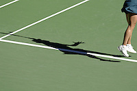 Shadow of a female tennis players during service;