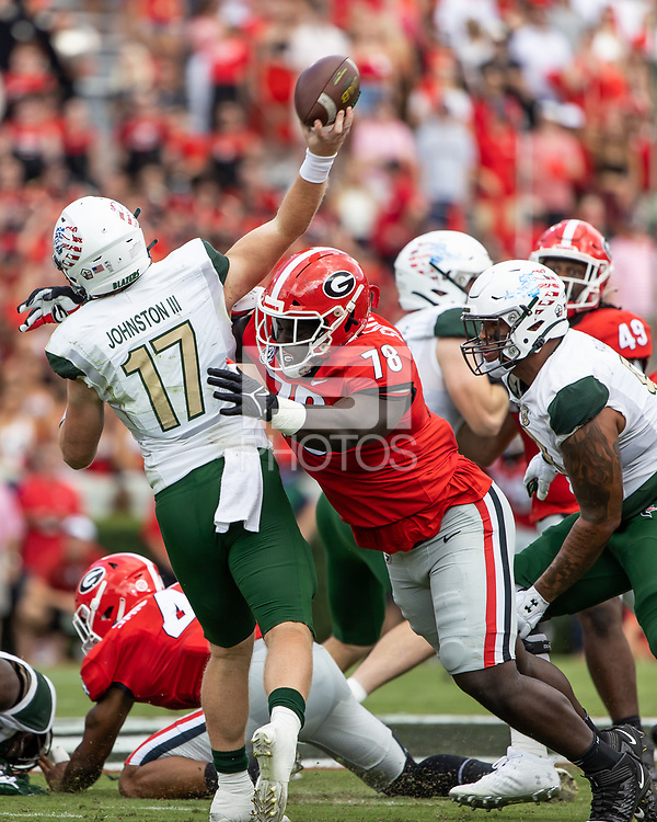 ATHENS, GA - SEPTEMBER 11: Nazir Stackhouse #78 of the Georgia Bulldogs tackles UAB Blazers quarterback Tyler Johnston III #17 as he releases the ball during a game between University of Alabama Birmingham Blazers and University of Georgia Bulldogs at Sanford Stadium on September 11, 2021 in Athens, Georgia.