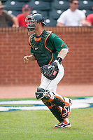 Yasmani Grandal #24 of the Miami Hurricanes jogs off the field at the 2010 ACC Baseball Tournament at NewBridge Bank Park May 27, 2010, in Greensboro, North Carolina.  The Eagles defeated the Hurricanes 12-10 in 10 innings.  Photo by Brian Westerholt / Four Seam Images