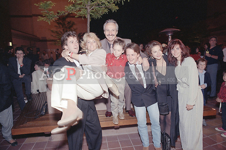 """May 01, 1989 - Los Angeles, California, USA - Cast members of NBC's """"Family Ties,"""" from left: Scott Valentine, Meredith Baxter Birney, Michael Gross, Brian Bonsall, Michael J. Fox, Justine Bateman and Courteney Cox, celebrate their seventh and final season, May 1, 1989, during a wrap party at the Gene Autry Western Heritage Museum in Los Angeles..(Credit Image: © Alan Greth)"""