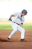 Max Burt (17) of the Pulaski Yankees puts on the brakes after rounding second base during the game against the Greeneville Reds at Calfee Park on June 23, 2018 in Pulaski, Virginia. The Reds defeated the Yankees 6-5.  (Brian Westerholt/Four Seam Images)