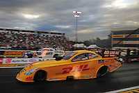 Sept. 30, 2011; Mohnton, PA, USA: NHRA funny car driver Jeff Arend (near lane) races alongside Jack Beckman during qualifying for the Auto Plus Nationals at Maple Grove Raceway. Mandatory Credit: Mark J. Rebilas-