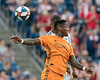 FOXBOROUGH, MA - JUNE 29: Romell Quioto #31, Brandon Bye #15 battle for head ball during a game between Houston Dynamo and New England Revolution at Gillette Stadium on June 29, 2019 in Foxborough, Massachusetts.