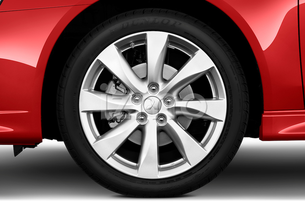 Tire and wheel close up detail view of a 2012 Mitsubishi Lancer GT Touring